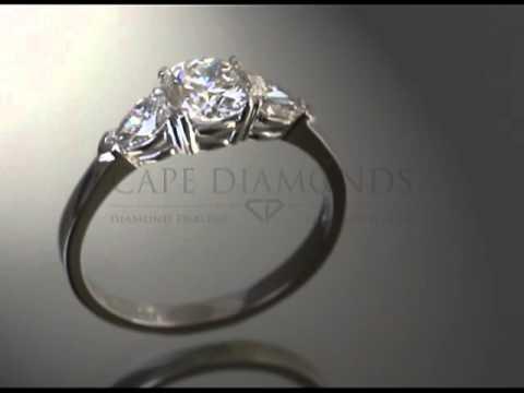 3stone ring,round white diamond,2 pear shaped diamonds,plain band,engagement ring