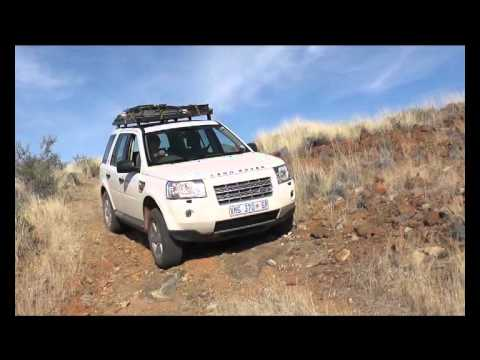 Liza drives a Landrover Freelander on a rough road in the Karoo