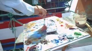 Laura & Leena painting boats