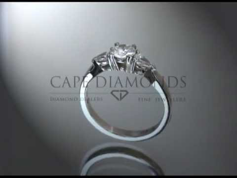 3 stone ring,round diamond,4 claws,2 pear shaped diamonds,platinum,engagement ring