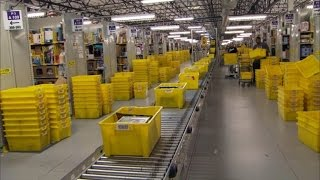 Watch Robots Work at Amazon Warehouse Where Cyber Monday Deals Are Packaged
