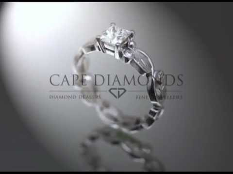 Organic ring design,cushion diamond,round diamonds and fittings on baroque band,engagement ring