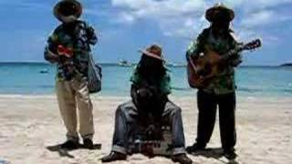 Being Serenaded on the beach in Negril