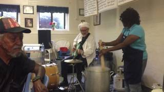Greenwood Soup Kitchen volunteer Lucy Mason dances while making gumbo with the 'Sauce Boss'