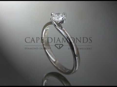 Solitaire ring,round diamond,4 claws,twist on top of band,platinum,engagement ring