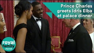 Prince Charles greets Idris Elba at palace dinner