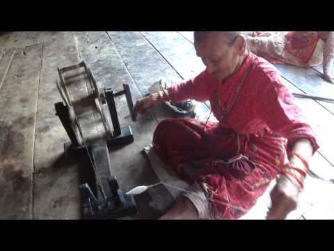 Old woman spinner in Bhaktapur Nepal