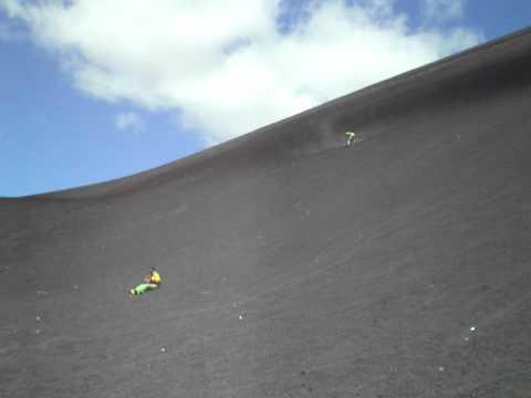 Sandboarding and sledding on volcano Cerro Negro, Nicaragua 2011.