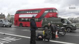 Bangs similar to gunfire heard outside Britain's parliament