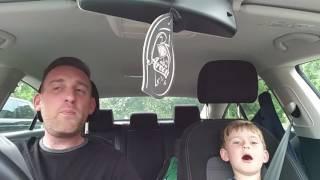 Dad and son sing Frank Sinatra in car. Original