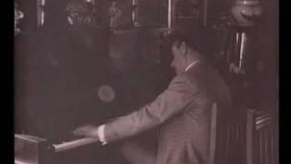 Giacomo Puccini playing piano