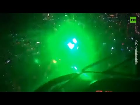 Chilean protesters use LASERS against police helicopter