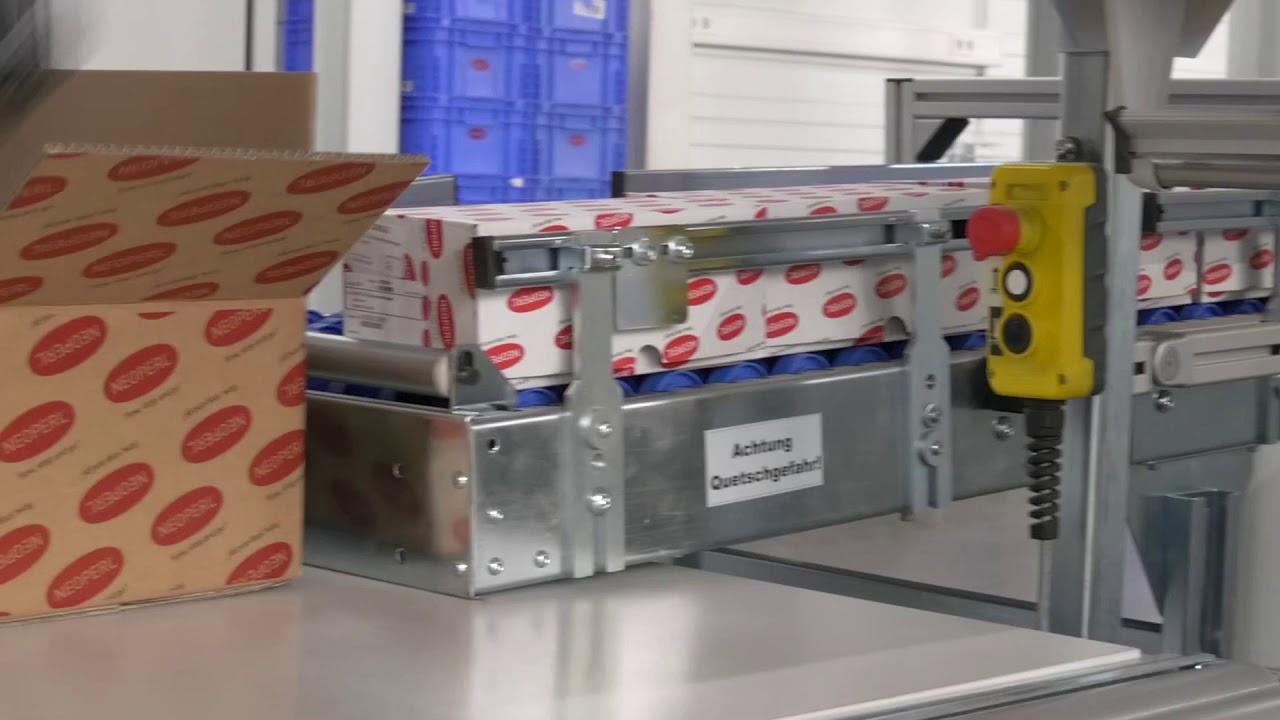 Verpackungsanlage mit AutoStore-Anbindung und Etikettierer