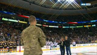 REUNION VIDEO - Soldier Surprises Parents at Center Ice During Hockey Game - Stunning!