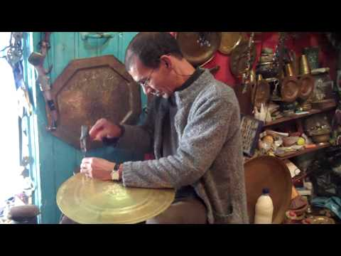 Hammering brass plates in Chefchaouen, Morocco
