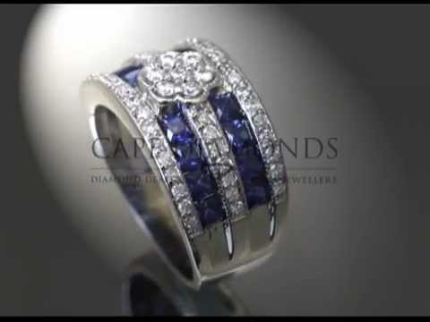 Complex stone ring,flower shaped,diamonds,tanzanites,complex side stones,engagement ring