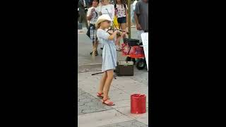 girl plays espasito with violin California