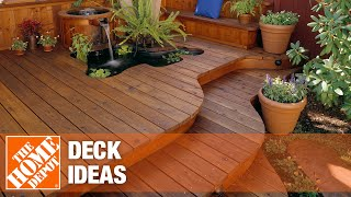 Outdoor furniture stands on a wooden deck that leads into a home's kitchen.
