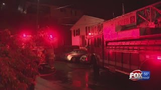 Neighbors pull elderly man from burning home