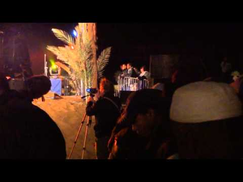 Guy dancing crazy with Tartit from Mali in Taragalte Festival 2012, Mhamid Sahara Desert Morocco