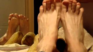 Wooden clogs removed, soft pale skin male feet (top, toes, soles, arches and heels ...)