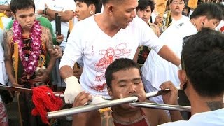 Extreme piercing for purity in Thai vegetarian festival