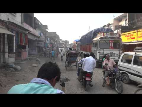 Crossing the border from Nepal to India by rickshaw.