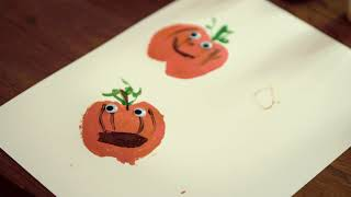 A page of fall pumpkin stamps with googly eyes.