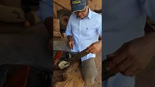 Como abaixar a guia da corrente do moto serra