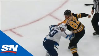 Trent Frederic Demolishes Brandon Tanev In First NHL Game, Parents Cheer and High-Five In Stands