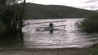 J2F-6 Grumman Duck go in water from a ramp