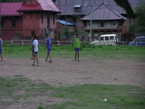 Cow playing football with kids, Nepal, round the world trip of David and Ronnie