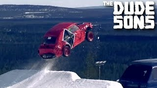 Huge Car Jump From A Snowboard Kicker