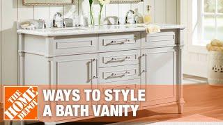 White single bath vanity styled in a modern way.