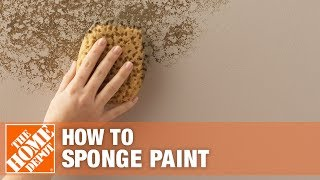 A person sponge painting a wall.