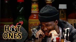 Curren$y Talks Munchies, Industry Games, and Rap Dogs While Eating Spicy Wings | Hot Ones