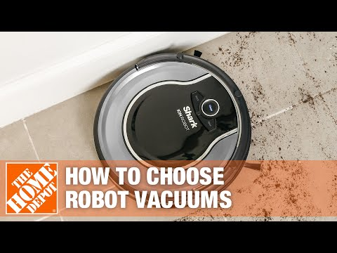 A robot vacuum on the floor of a living room