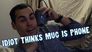 idiot thinks mug is phone