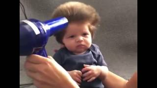 cute baby blow drying his hair