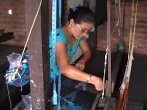 Yashodha Shrestha weaving Kalpana's rocket design