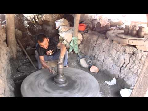 Potter working on a gray clay vase in Bhaktapur Nepal