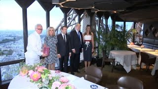 Macron welcomes Trump to Eiffel Tower dinner