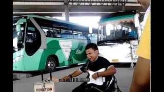 Blind man singing a song of Yoyoy Villame in Gensan Bus Terminal