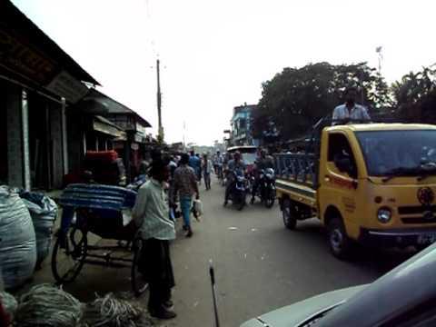 Driving through a small city in Bangladesh
