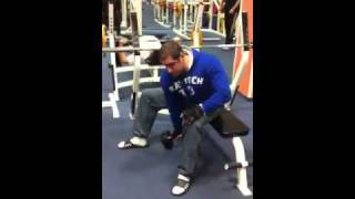 Live trainer biceps sitting from knee dumbbells