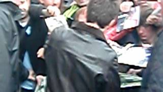 Noel Gallagher signs stuff after soundcheck in Manchester - 26/10/2011