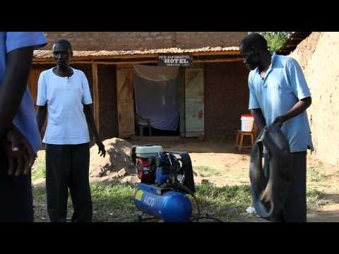 How to fix a flat tire in a small village in Kenya Africa