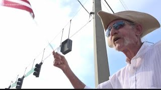 Orange Park veteran spends several hours of 4th of July morning waving his flag