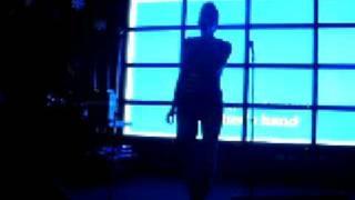 Noelle singing an 80's jam at karaoke night