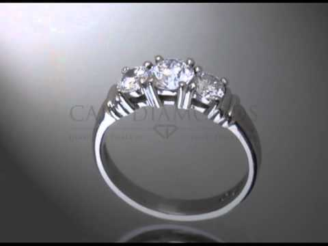 3 stone ring,round diamonds,2 platinum bars a side,enagement ring